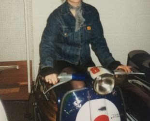 Loretta ( my better half) smiling even though it was her scooter and i sold it to Wellers record company